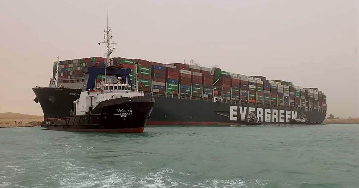 Stranded container ship blown sideways in dust storm blocks key global shipping route